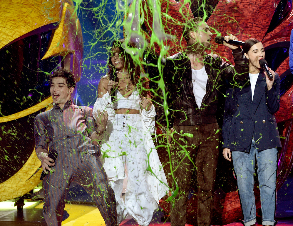 ". Ludi Lin, from left, Becky G, Dacre Montgomery, and Naomi Scott, from the cast of ""Power Rangers,\"" get slimed on stage at the Kids\' Choice Awards at the Galen Center on Saturday, March 11, 2017, in Los Angeles. (Photo by Chris Pizzello/Invision/AP)"