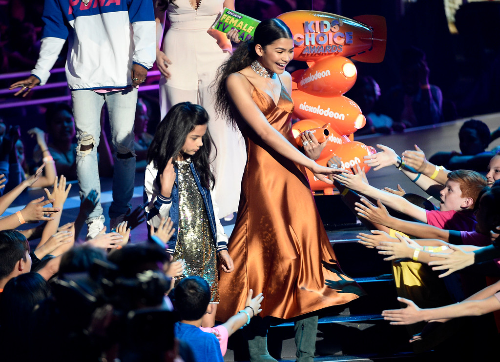 """. Zendaya greets fans in the audience after accepting the award for favorite female TV star for \""""K.C. Undercover\"""" at the Kids\' Choice Awards at the Galen Center on Saturday, March 11, 2017, in Los Angeles. (Photo by Chris Pizzello/Invision/AP)"""