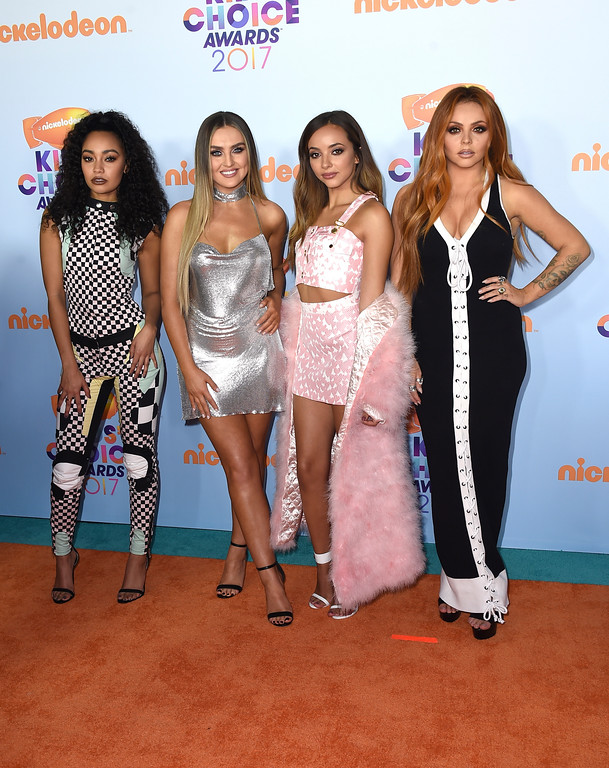 ". Leigh-Anne Pinnock, from left, Perrie Edwards, Jade Thirlwall, and Jesy Nelson of ""Little Mix\"" arrive at the Kids\' Choice Awards at the Galen Center on Saturday, March 11, 2017, in Los Angeles. (Photo by Jordan Strauss/Invision/AP)"