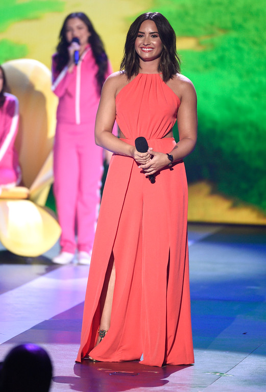 """. Demi Lovato introduces a clip from \""""Smurfs: The Lost Village\"""" at the Kids\' Choice Awards at the Galen Center on Saturday, March 11, 2017, in Los Angeles. (Photo by Chris Pizzello/Invision/AP)"""