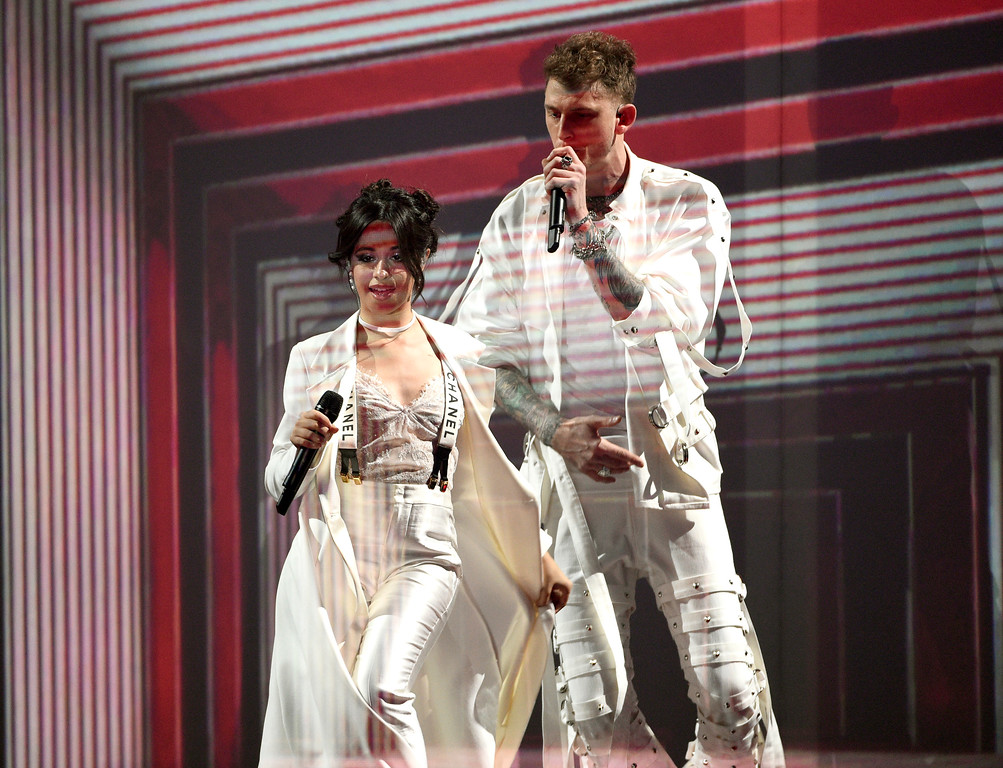 """. Machine Gun Kelly, right, and Camila Cabello perform \""""Bad Things\"""" at the Kids\' Choice Awards at the Galen Center on Saturday, March 11, 2017, in Los Angeles. (Photo by Chris Pizzello/Invision/AP)"""