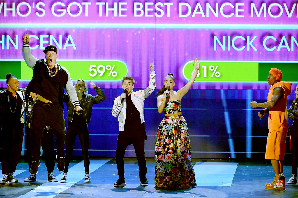 . LOS ANGELES, CA - MARCH 11:  (L-R) Host John Cena, actors Jack Griffo, Kira Kosarin and Nick Cannon speak onstage at Nickelodeon\'s 2017 Kids\' Choice Awards at USC Galen Center on March 11, 2017 in Los Angeles, California.  (Photo by Kevin Winter/Getty Images)