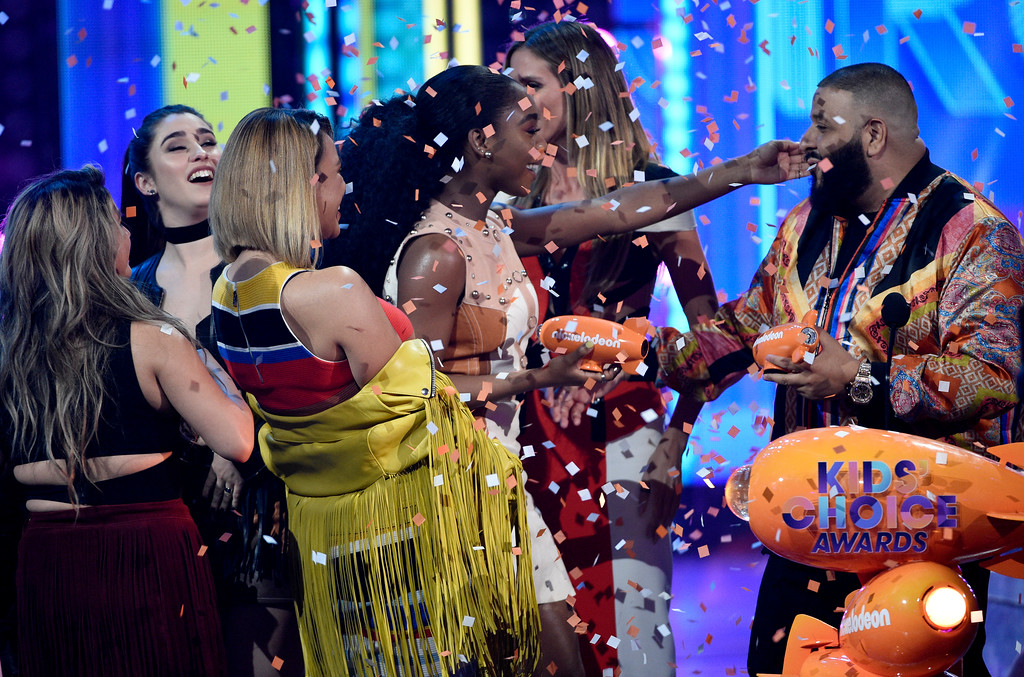 . DJ Khaled, from right, presents the award for favorite music group to Normani Kordei, Dinah Jane, Lauren Jauregui, and Ally Brooke, of Fifth Harmony, at the Kids\' Choice Awards at the Galen Center on Saturday, March 11, 2017, in Los Angeles. (Photo by Chris Pizzello/Invision/AP)