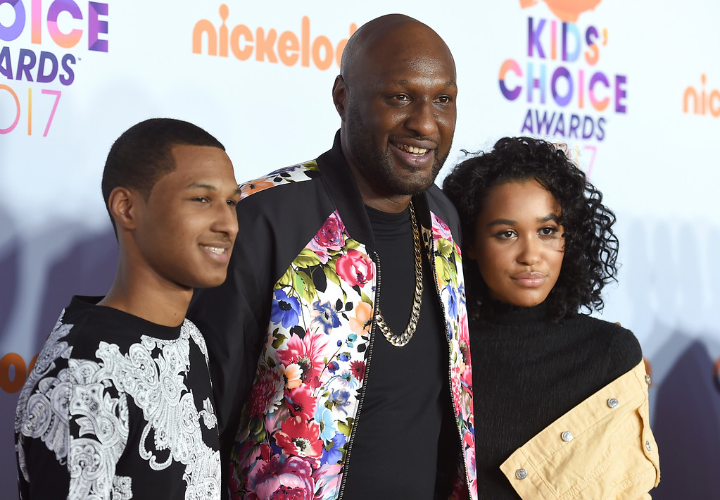 . Lamar Odom Jr, from left, Lamar Odom, and Destiny Odom arrive at the Kids\' Choice Awards at the Galen Center on Saturday, March 11, 2017, in Los Angeles. (Photo by Jordan Strauss/Invision/AP)
