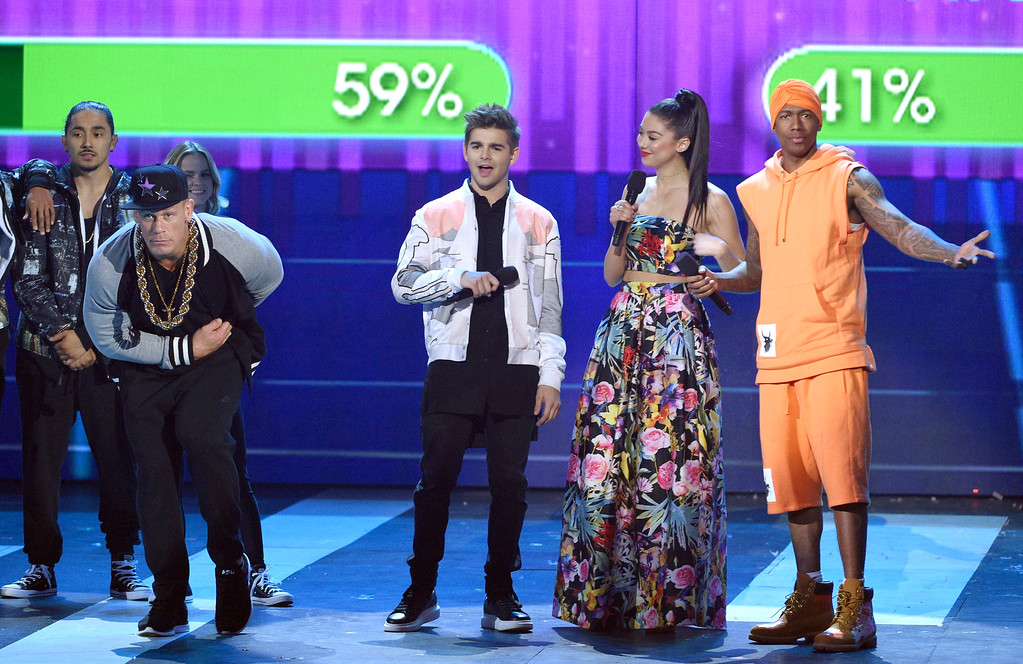 . Jack Griffo, center left, and Kira Kosarin, center right, host a dance battle between John Cena, left, and Nick Cannon, right at the Kids\' Choice Awards at the Galen Center on Saturday, March 11, 2017, in Los Angeles. (Photo by Chris Pizzello/Invision/AP)