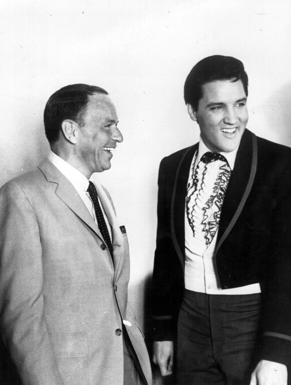 . 18th June 1965:  The most popular male voices in the USA, singers Frank Sinatra (1915 - 1998), left, and Elvis Presley (1935 - 1977) share a joke together in Hollywood, unusual as both of the stars are adverse to posing for press photographers. Sinatra was on the set of the film \'Frankie And Johnny\' and Presley had just donated $50, 000 to the Motion Pictures Relief Fund to aid needy actors and actresses.  (Photo by Keystone/Getty Images)