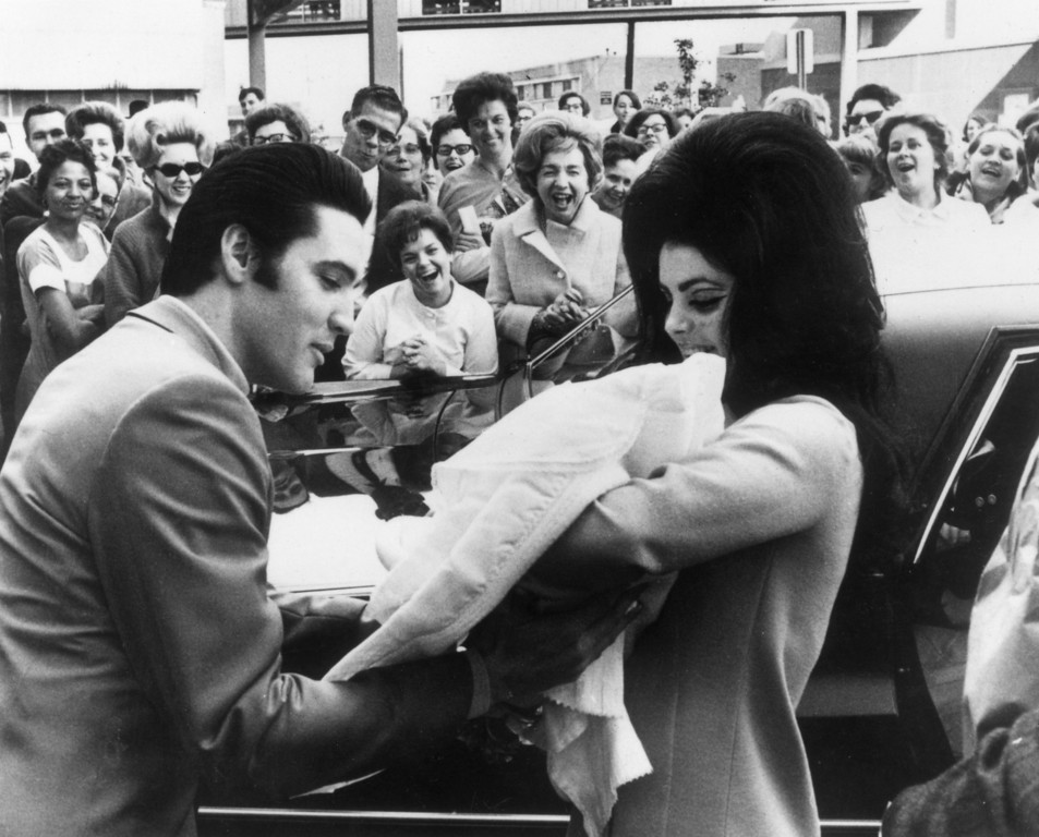 . 13th February 1968:  Elvis and Priscilla Presley with their daughter, Lisa Marie, born on 2nd February.  (Photo by Keystone/Getty Images)