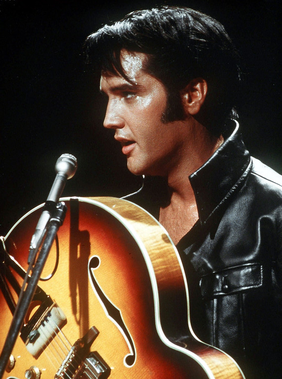 . Actor/singer Elvis Presley holds his semi-acoustic guitar during a concert in the USA, in December of 1968. (AP Photo)
