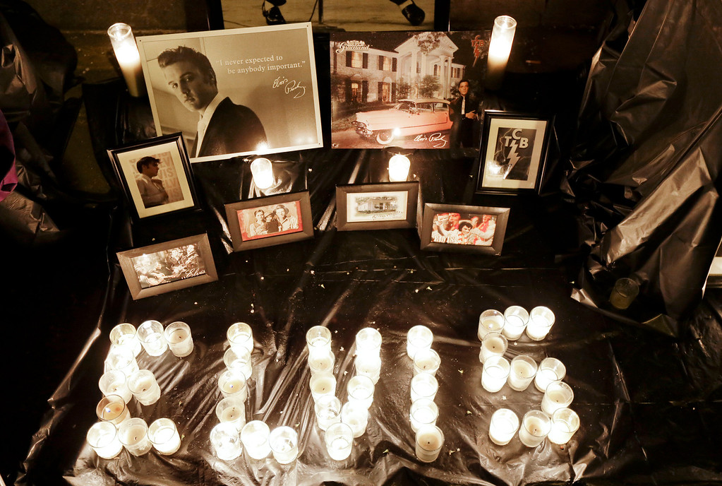 . A memorial to Elvis Presley is displayed outside Graceland, Presley\'s Memphis, Tenn. home, on Wednesday, Aug. 15, 2012. Fans from around the world are at Graceland to commemorate the 35th anniversary of Presley\'s death. (AP Photo/Mark Humphrey)