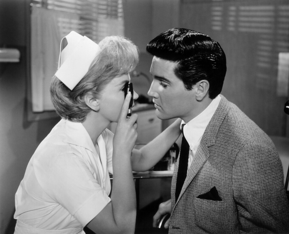 . July 1963:  Elvis Presley (1935 - 1977) and Joan O\'Brien play nurse and patient in director Norman Taurog\'s film \'It Happened At The World\'s Fair\'.  (Photo by Evening Standard/Getty Images)
