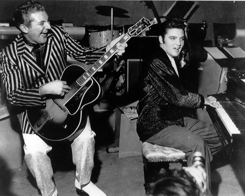 . Piano virtuoso Liberace is shown playing the guitar with Elvis Presley at the piano in November 1956 at the Riviera Hotel in Las Vegas.  (AP Photo)