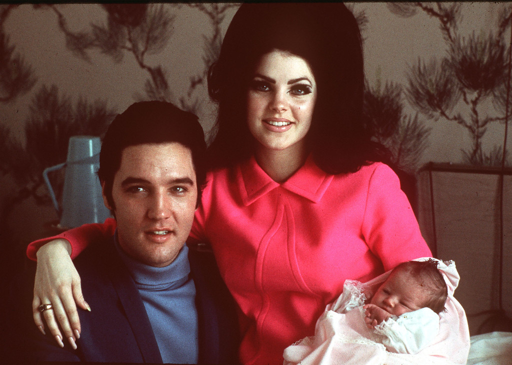 . Elvis Presley poses with wife Priscilla and daughter Lisa Marie, in a room at Baptist hospital in Memphis, Tenn., February 05, 1968. (AP Photo)