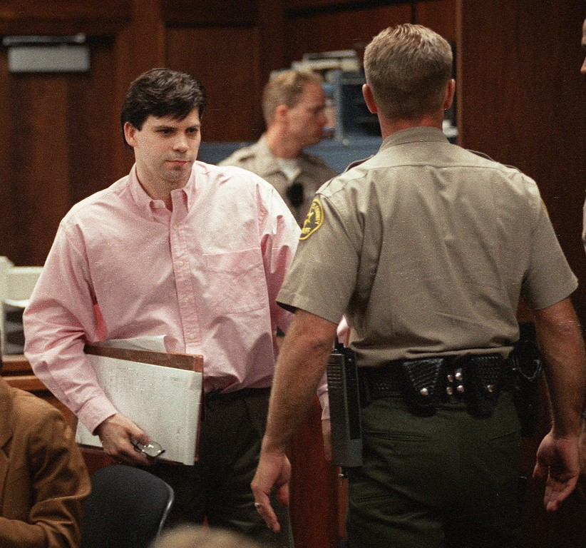 . Lyle Menendez stands up to leave the courtroom in the Van Nuys section of Los Angeles Tuesday, July 2, 1996, after he was sentenced to two consecutive life sentences for the murders of his parents, Jose and Kitty Menendez. Lyle and his brother, Erik, were sentenced nearly seven years after the murders. (AP Photo/Pool, Sam Mircovich)
