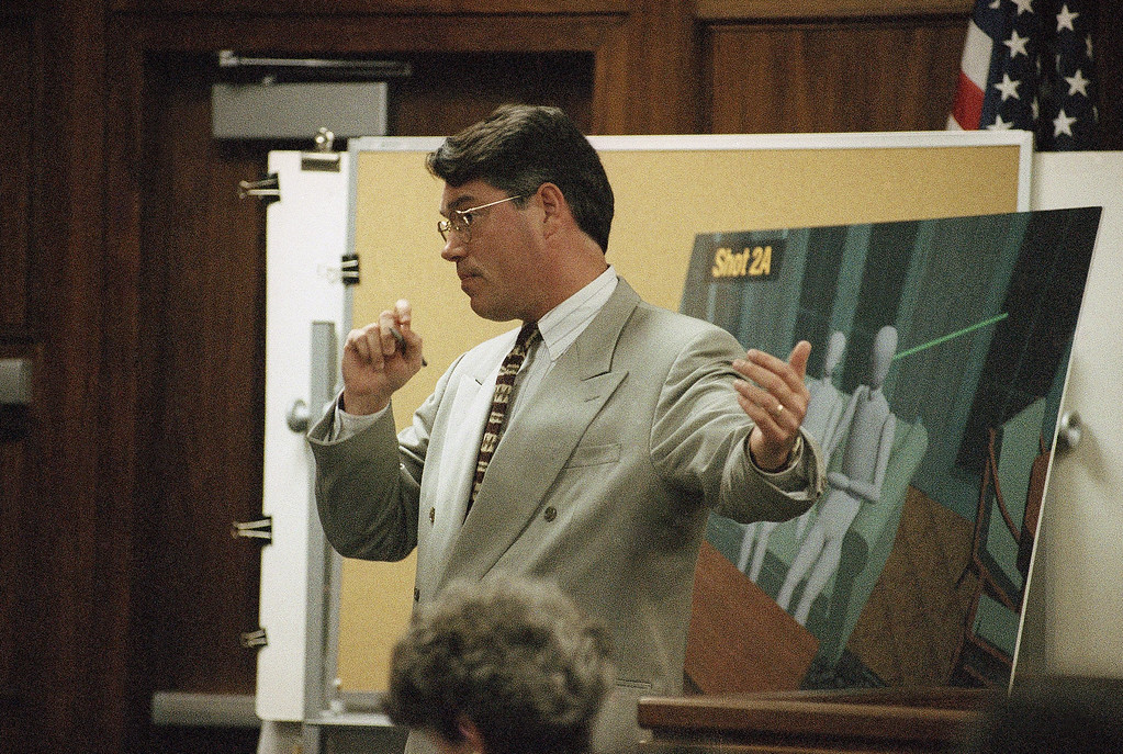 . File - Prosecutor David Conn presents final arguments to the jury in the Erik and Lyle Menendez murder trial in the Van Nuys section of Los Angeles on Thursday, Feb. 22, 1996. For the second time in as many days, final arguments prompted a motion for mistrial based on Conn\'s suggestion there wasn\'t enough evidence to show the brothers were abused by their parents. (AP Photo/Nick Ut)