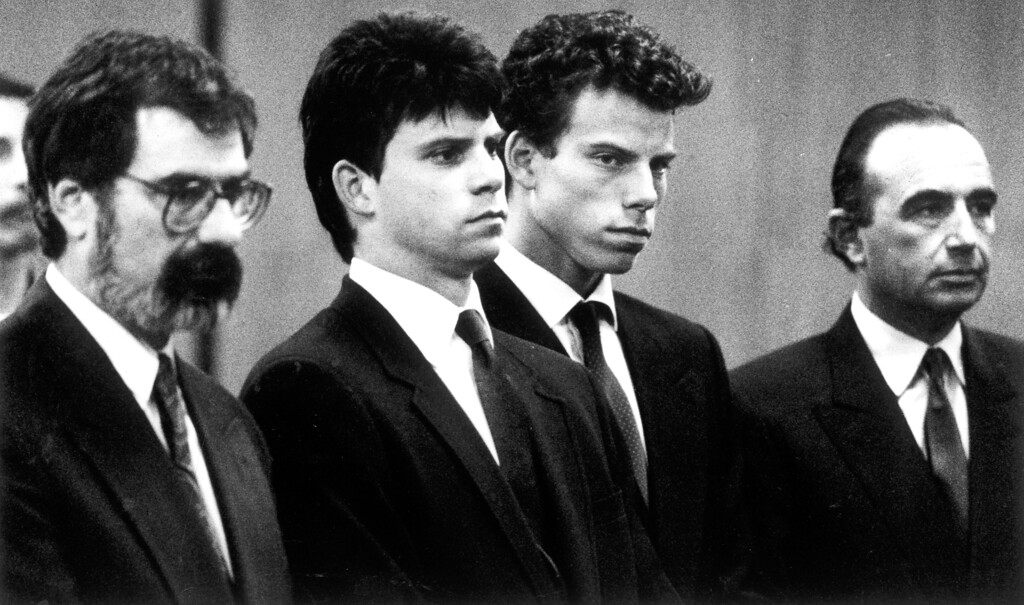 . From left, attorney Gerald Chaleff, Lyle Menendez, Erik Menendez and attorney Robert Shapiro on March 12, 1990.   (L.A. Daily News file photo)