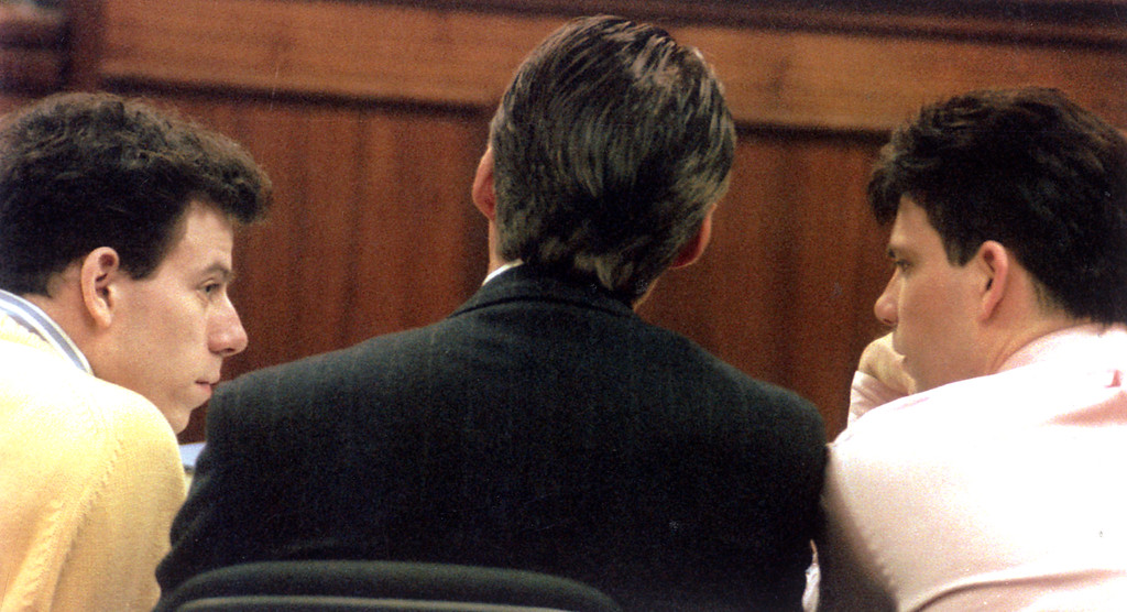 . Defendants Erik and Lyle Menendez confer in court with Lyle\'s attorney, Michael Burt on December 3, 1993.   (L.A. Daily News file photo)