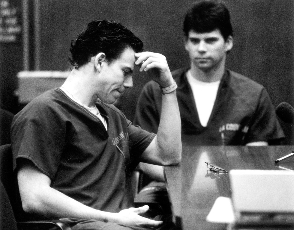 . Erik Menendez, left, and brother Lyle react to the judge\'s ruling that counseling session tapes can be used as evidence. (8/6/90)   (L.A. Daily News file photo)