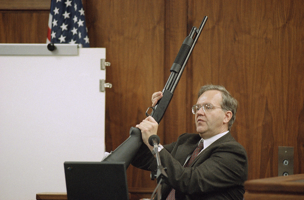 . Roger McCarthy, chief executive officer of Failure Analysis Associates, demonstrates, shot-by-shot, how he believes Erik and Lyle Menendez murdered their parents during testimony for the prosecution in Van Nuys Superior Court in Los Angeles, Nov. 9, 1995. He will be testifying again next week in the Menendez brothers? second trial for the murders of their parents and present a re-enactment. (AP Photo/Reed Saxon)