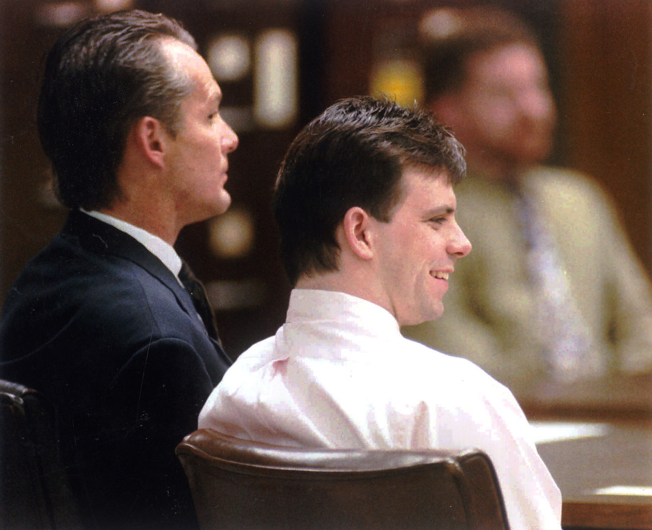 . Lyle Menendez smiles and attorney Michael Burt pays attention Friday as a mistrial is declared in Menendez\'s murder trial.  (1/28/94) (L.A. Daily News file photo)