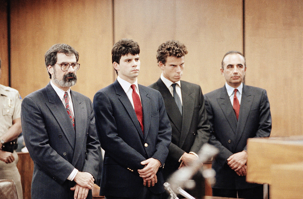 """. Lyle Menendez, second from left, and his brother, Erik, second from right, are flanked by their attorneys Gerald Chaleff, left, and Robert Shapiro, as the brothers delayed entering pleas through their attorneys in Beverly Hills Municipal Court, March 13, 1990. The brothers are suspected in the murders of their millionaire parents, Jose and Mary Louise \""""Kitty\"""" Menendez, in Beverly Hills, California on August 20, 1989. (AP Photo/Nick Ut)"""