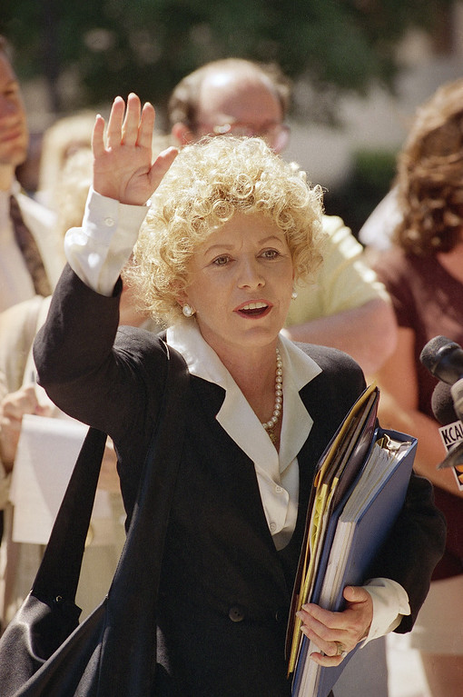 . Leslie Abramson, defense attorney for Erik Menendez, waves goodbye to reporters after Superior Court Judge Stanley Weisberg sentenced Erik and his brother Lyle to life in prison without possibility of parole in the Van Nuys section of Los Angeles on Tuesday, July 2, 1996. The brothers were sentenced nearly seven years after they killed their wealthy parents in a salvo of shotgun blasts. (AP Photo/Mark J. Terrill)