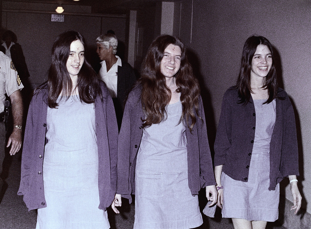 . Susan Atkins, Patricia Krenwinkel and Leslie Van Houten, left to right, are shown en route to court in Los Angeles, Ca., Aug. 1970. The three women, displaying the symbol X on their foreheads as followers of the Manson cult family, are on trial for killings that included actress Sharon Tate. (AP Photo)