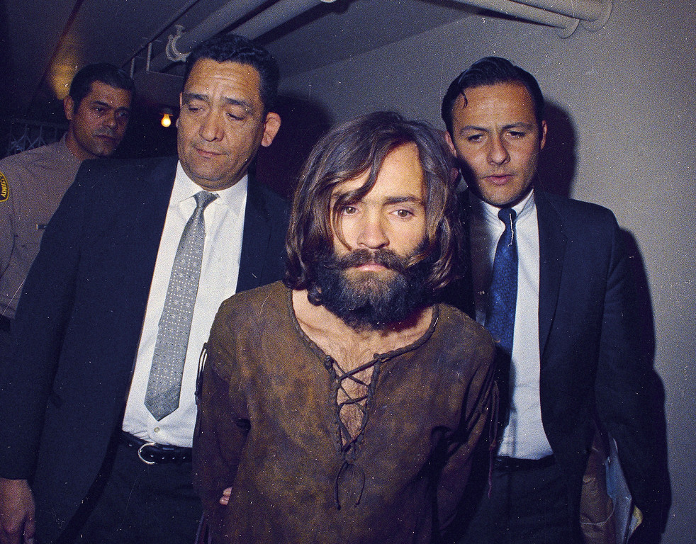 . Charles Manson is escorted to his arraignment on conspiracy-murder charges in connection with the Sharon Tate murder case, 1969, Los Angeles, Calif.  (AP Photo)