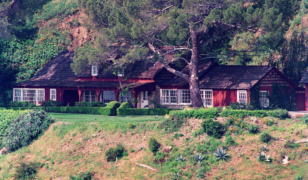 """. This 1992 file photo shows the Benedict Canyon estate, sheltered in the hills of Los Angeles, where actress Sharon Tate was murdered along with four others on the night of Aug. 9, 1969. Manson \""""family\"""" members were kids. Vulnerable, alienated, running away from a world wracked by war and rebellion. They turned to a cult leader for love and wound up tied to a web of unimaginable evil, and now, on the brink of old age, they are the haunted. (AP Photo/Reed Saxon, File)"""