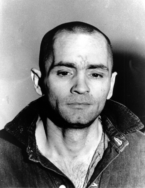 . Charles Manson is pictured en route to the courtroom after being told the jury had decided on his punishment for the Sharon Tate murders in Los Angeles, Ca., on April 19, 1971.  Manson began making derogatory remarks as soon as he entered the courtroom and was taken to another room before the jury sentenced him and three women co-defendents to death in the gas chamber.  (AP Photo)