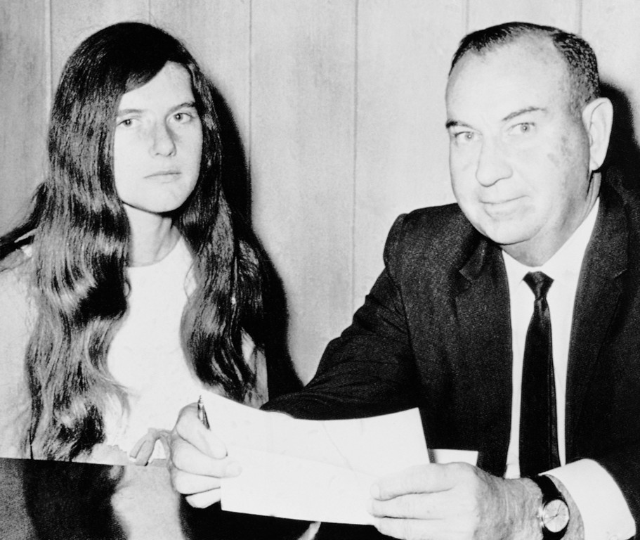 . Patricia Krenwinkel, 22, of Los Angeles, left, is shown in the courthouse with her attorney, M.A. Marsal before a hearing at which Marsal sought her release on bond, Thursday, Dec. 4, 1969, Mobile, Ala. She bad been arrested on a fugitives warrant based on murder charges in Los Angeles in the Sharon Tate murder case. A judge said he would rule on Friday. (AP Photo)