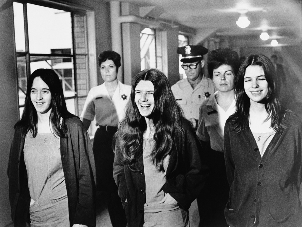 . Three female defendants in the Sharon Tate murder trial burst out laughing as they come within range of news cameras en route to court in Los Angeles, Aug. 11, 1970.  Left to right: Susan Denise Atkins, Patricia Krenwinkel, Leslie Van Houten. (AP Photo)