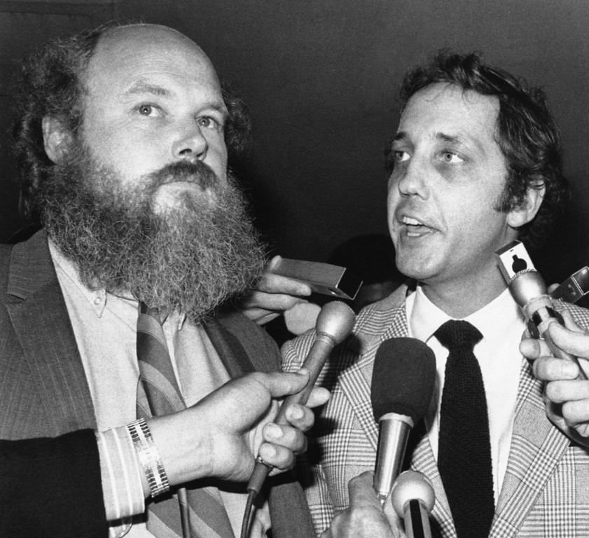 ". Attorneys Ronald Hughes, left, and Paul Fitzgerald, seen Aug. 3, 1970, who represent Charles Manson and others being tried for murder in Los Angeles, tell newsmen outside the courtroom they object to President Nixon saying in Los Angeles that Manson was ""Guilty, directly or indirectly, of eight murders.\"" Kanarek later moved for a mistrial, but it was denied. (AP Photo)"
