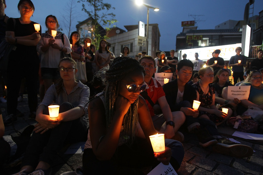 . SEOUL, SOUTH KOREA - JUNE 13:  People gather during a vigil in downtown Seoul to remember victims of the shooting at an Orlando nightclub on June 13, 2016 in Seoul, South Korea. An American-born man who had recently pledged allegiance to ISIS killed 50 people early morning on June 12, 2016 at a gay nightclub in Orlando, Florida. The massacre was the deadliest mass shooting in the United States.  (Photo by Chung Sung-Jun/Getty Images)