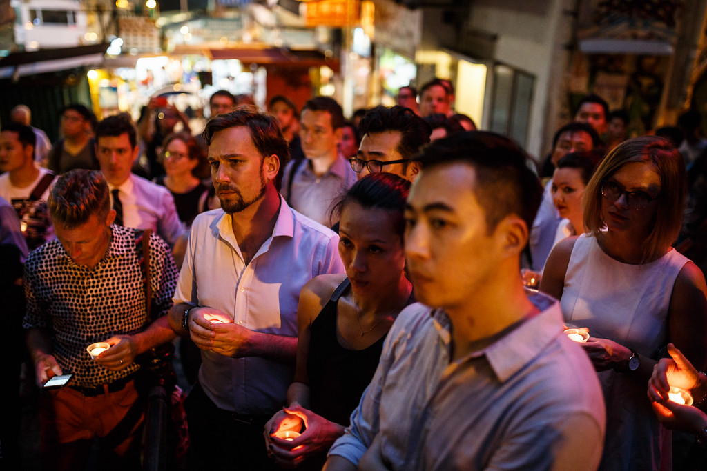 . People hold candles as they share a minute of silence during a vigil for the victims of the Orlando shooting in Florida, in Hong Kong on June 13, 2016. Law enforcement authorities have lowered the death toll from the weekend massacre at a gay nightclub in Orlando to 49, the deadliest mass shooting in American history, explaining that the shooter had been counted in the original tally. (ANTHONY WALLACE/AFP/Getty Images)