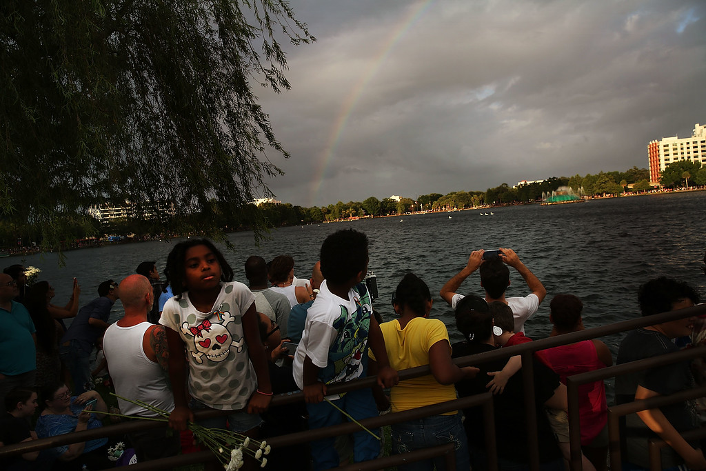 . ORLANDO, FL - JUNE 19: A rainbow forms as people attend a memorial service on June 19, 2016 in Orlando, Florida. Thousands of people are expected at the evening event which will feature entertainers, speakers and a candle vigil at sunset. In what is being called the worst mass shooting in American history, Omar Mir Seddique Mateen killed 49 people at the popular gay nightclub early last Sunday. Fifty-three people were wounded in the attack which authorities and community leaders are still trying to come to terms with. (Photo by Spencer Platt/Getty Images)