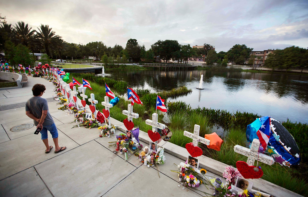 . Crosses, one for each victim, line a walkway as a memorial to those killed a week ago in the Pulse nightclub mass shooting a few blocks from the club early Sunday, June 19, 2016, in Orlando, Fla. (AP Photo/David Goldman)