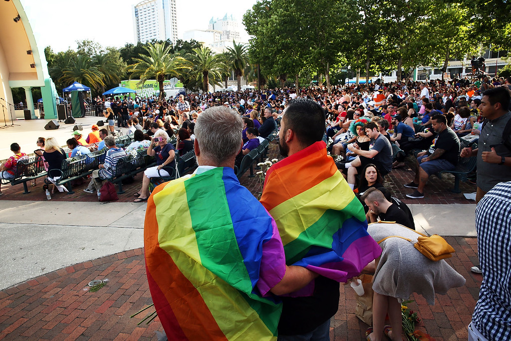 . ORLANDO, FL - JUNE 19: People wait for the start of a memorial service on June 19, 2016 in Orlando, Florida. Thousands of people are expected at the evening event which will feature entertainers, speakers and a candle vigil at sunset. In what is being called the worst mass shooting in American history, Omar Mir Seddique Mateen killed 49 people at the popular gay nightclub early last Sunday. Fifty-three people were wounded in the attack which authorities and community leaders are still trying to come to terms with. (Photo by Spencer Platt/Getty Images)