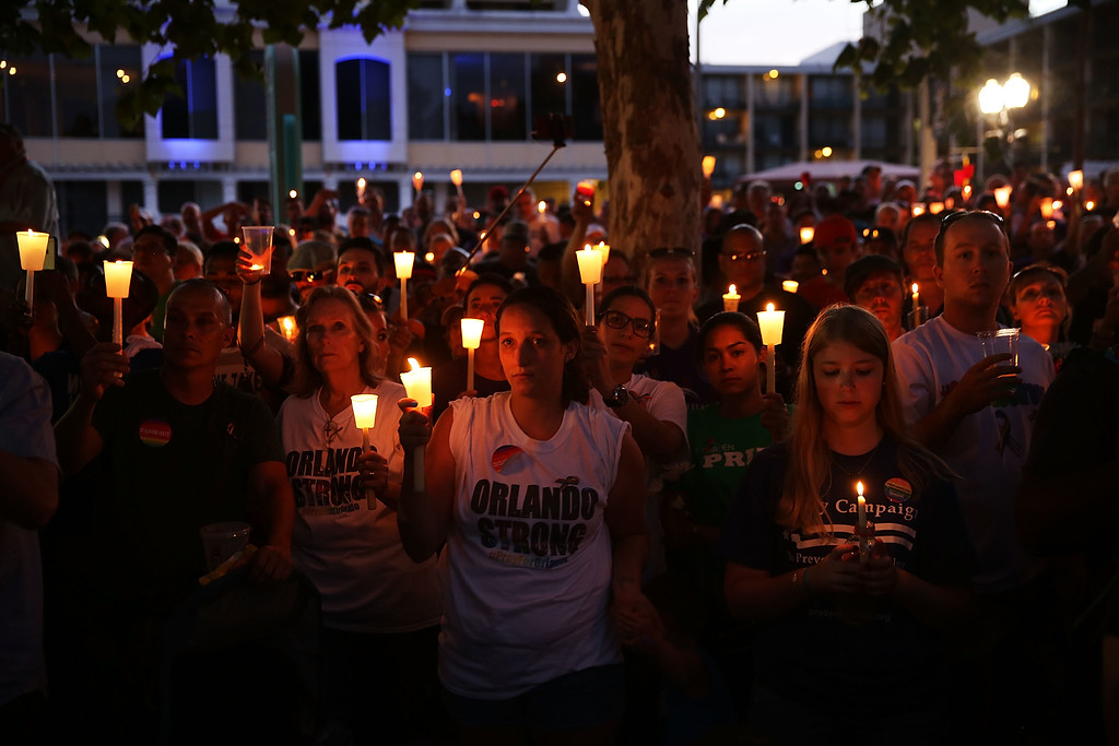 . ORLANDO, FL - JUNE 19: People attend a memorial service on June 19, 2016 in Orlando, Florida. Thousands of people are expected at the evening event which will feature entertainers, speakers and a candle vigil at sunset. In what is being called the worst mass shooting in American history, Omar Mir Seddique Mateen killed 49 people at the popular gay nightclub early last Sunday. Fifty-three people were wounded in the attack which authorities and community leaders are still trying to come to terms with. (Photo by Spencer Platt/Getty Images)