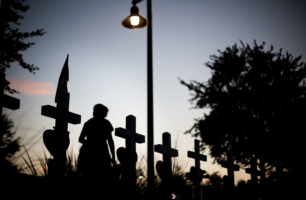 . Crosses, one for each victim, line a walkway as a memorial to those killed in the Pulse nightclub mass shooting a few blocks from the club, early Friday, June 17, 2016, in Orlando, Fla. (AP Photo/David Goldman)