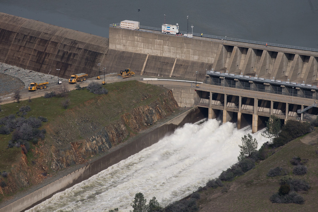 . OROVILLE, CA - FEBRUARY 13: The main spillway, which was damaged earlier this week, is seen in use from the air on February 13, 2017 in Oroville, California. Almost 200,000 people were ordered to evacuate the northern California town after a hole in an emergency spillway in the Oroville Dam threatened to flood the surrounding area. (Photo by Elijah Nouvelage/Getty Images)