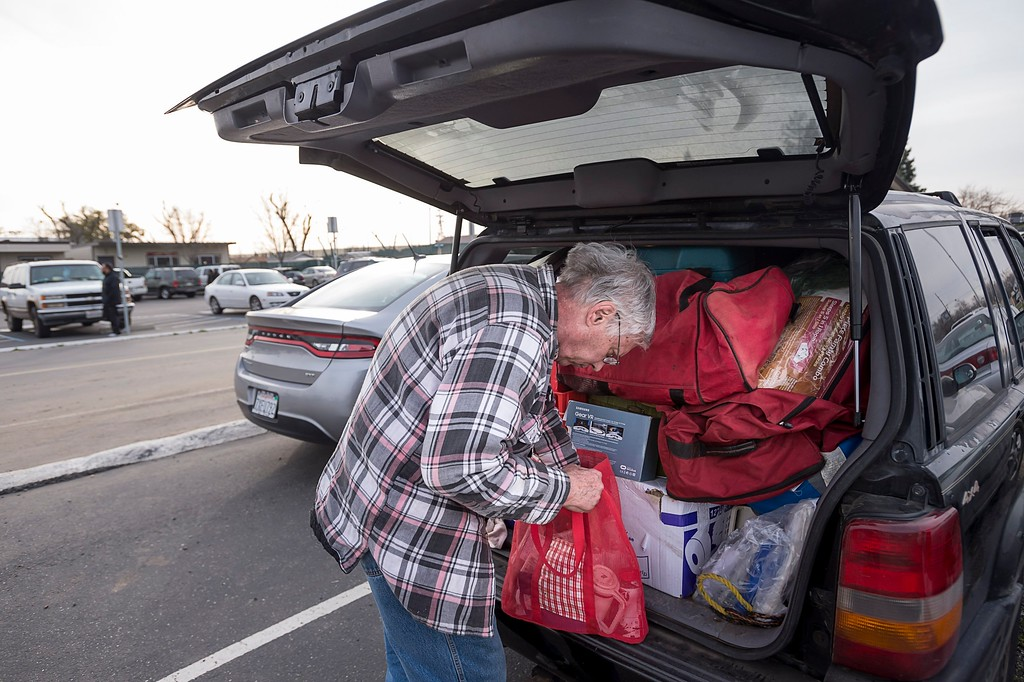 . Paula Gillock, 53, waits in line for breakfast at the Silver Dollar Fairground on Monday, Feb. 13, 2017, in Chico, Calif., after residents were evacuated from the possible failure of the emergency spillway at the Oroville Dam. Sunday afternoon\'s evacuation order came after engineers spotted a hole on the concrete lip of the secondary spillway for the 770-foot-tall Oroville Dam and told authorities that it could fail within the hour. The water level dropped Monday, reducing the risk of a catastrophic spillway collapse and easing fears that prompted the evacuation of nearly 200,000 people downstream.(Paul Kitagaki Jr./The Sacramento Bee via AP)