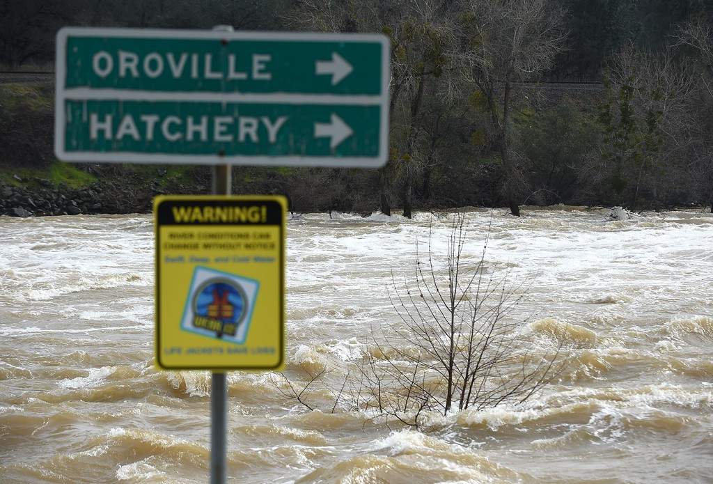 . A sign is seen submerged by flowing water near Oroville, California on February 13, 2017. Almost 200,000 people were under evacuation orders in northern California Monday after a threat of catastrophic failure at the United States\' tallest dam. Officials said the threat had subsided for the moment as water levels at the Oroville Dam, 75 miles (120 kilometers) north of San Francisco, have eased. But people were still being told to stay out of the area. (JOSH EDELSON/AFP/Getty Images)