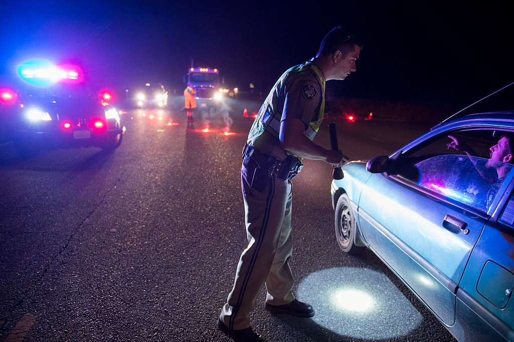 . California Highway Patrol officer Ken Weckman directs traffic as residents evacuate Marysville, Calif., Sunday, Feb. 12, 2017. Thousands of residents of Marysville and other Northern California communities were told to leave their homes Sunday evening as an emergency spillway of the Oroville Dam could fail at any time unleashing flood waters from Lake Oroville, according to officials from the California Department of Water Resources. (Paul Kitagaki Jr./The Sacramento Bee via AP)