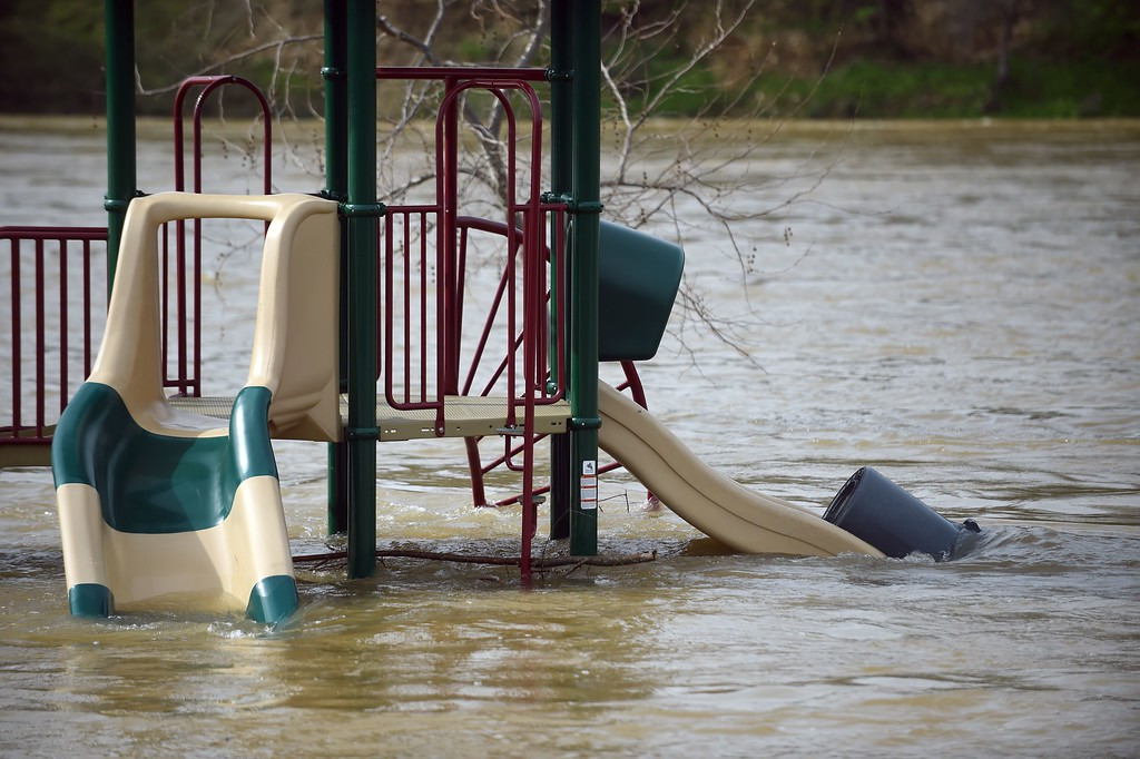 . A swing is seen partially submerged in flowing water at Riverbend Park in Oroville, California on February 13, 2017. Almost 200,000 people were under evacuation orders in northern California Monday after a threat of catastrophic failure at the United States\' tallest dam. Officials said the threat had subsided for the moment as water levels at the Oroville Dam, 75 miles (120 kilometers) north of San Francisco, have eased. But people were still being told to stay out of the area. (JOSH EDELSON/AFP/Getty Images)