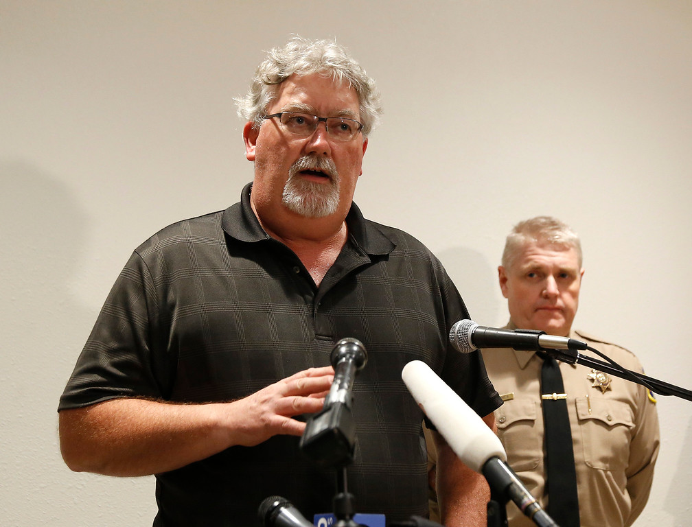 . Bill Croyle, acting Director of the California Department of Water Resources, speaks as Butte County Sheriff Kory Honea listens at a news conference about the situation at the Oroville Dam on Sunday, Feb. 12, 2017, in Marysville, Calif. Croyle said officials will be able to assess the damage to the emergency spillway now that the water is no longer spilling over the top. Honea said evacuation orders affecting thousands of people will stand until there is more information on the condition of the nation\'s tallest dam\'s emergency spillway. (AP Photo/Rich Pedroncelli)