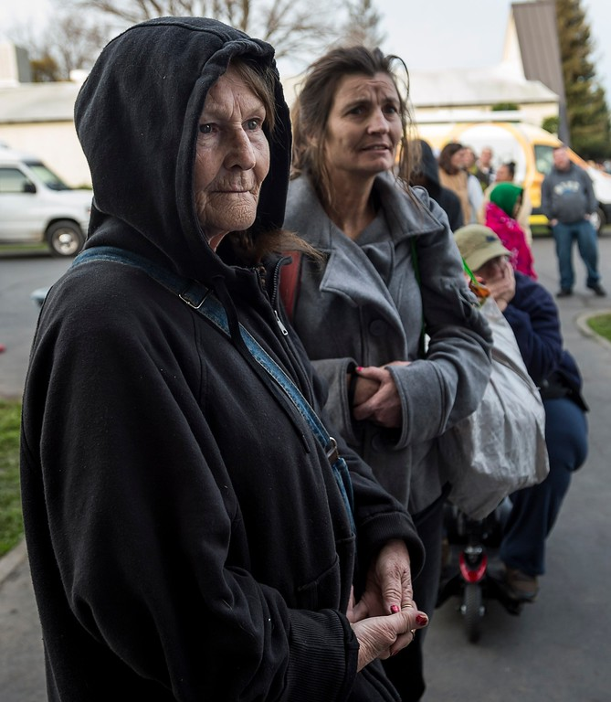 . Oroville residents Katherine March, 63, and her daughter Penny Conn, 48, wait in line for a hot meal at the Silver Dollar Fairgrounds on Monday, Feb. 13, 2017 in Chico, Calif., after residents were evacuated from the area due to fears of a possible failure of the emergency spillway at the Oroville Dam. Sunday afternoon\'s evacuation order came after engineers spotted a hole on the concrete lip of the secondary spillway for the 770-foot-tall Oroville Dam and told authorities that it could fail within the hour. The water level dropped Monday, reducing the risk of a catastrophic spillway collapse and easing fears that prompted the evacuation of nearly 200,000 people downstream.(Paul Kitagaki Jr./The Sacramento Bee via AP)