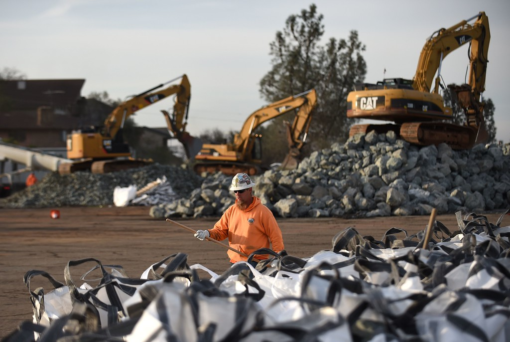 . A worker who declined to give his name works with bags of rocks in preparation for emergency measures taken at the Oroville Dam in Oroville, California on February 13, 2017. Almost 200,000 people were under evacuation orders in northern California Monday after a threat of catastrophic failure at the United States\' tallest dam. Officials said the threat had subsided for the moment as water levels at the Oroville Dam, 75 miles (120 kilometers) north of San Francisco, have eased. But people were still being told to stay out of the area.  (JOSH EDELSON/AFP/Getty Images)