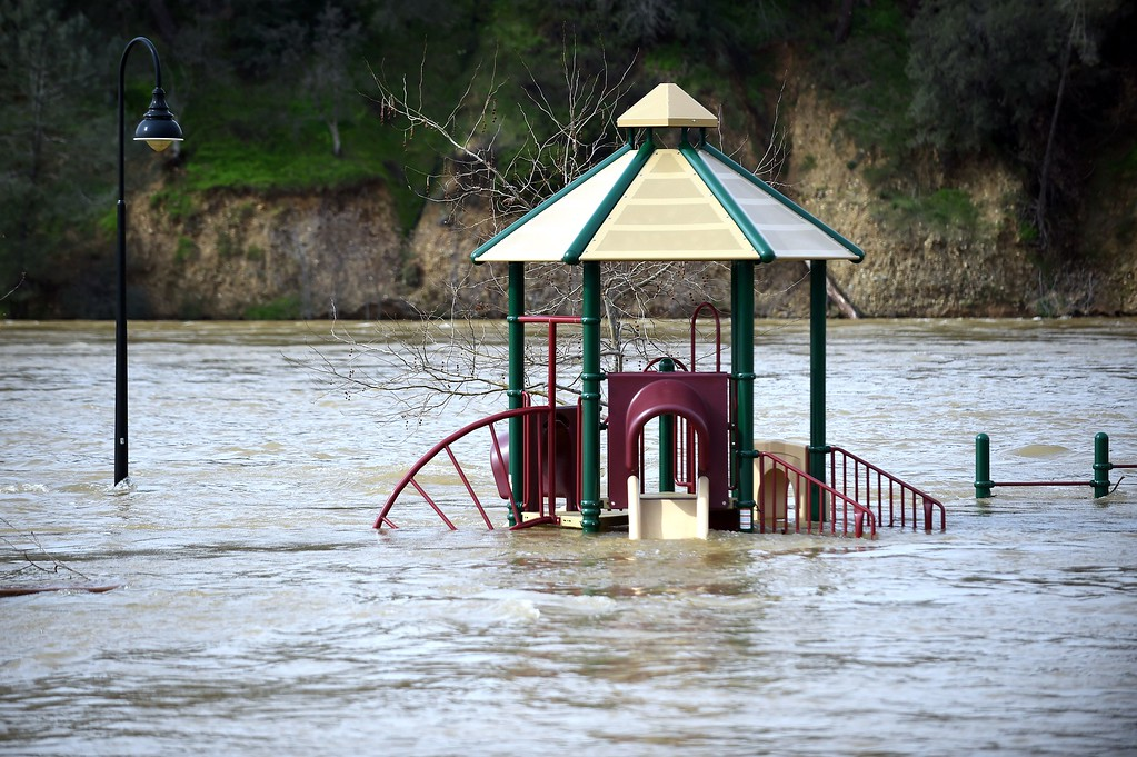 . A playground is seen submerged in flowing water at Riverbend Park as the Oroville Dam releases water down the spillway in Oroville, California on February 13, 2017. Almost 200,000 people were under evacuation orders in northern California Monday after a threat of catastrophic failure at the United States\' tallest dam. Officials said the threat had subsided for the moment as water levels at the Oroville Dam, 75 miles (120 kilometers) north of San Francisco, have eased. But people were still being told to stay out of the area. (JOSH EDELSON/AFP/Getty Images)