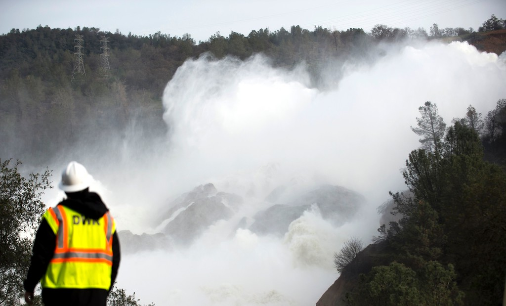 . A water utility worker looks towards discharging water as it is released down a spillway as an emergency measure at the Oroville Dam in Oroville, California on February 13, 2017. Almost 200,000 people were under evacuation orders in northern California Monday after a threat of catastrophic failure at the United States\' tallest dam. Officials said the threat had subsided for the moment as water levels at the Oroville Dam, 75 miles (120 kilometers) north of San Francisco, have eased. But people were still being told to stay out of the area. (JOSH EDELSON/AFP/Getty Images)