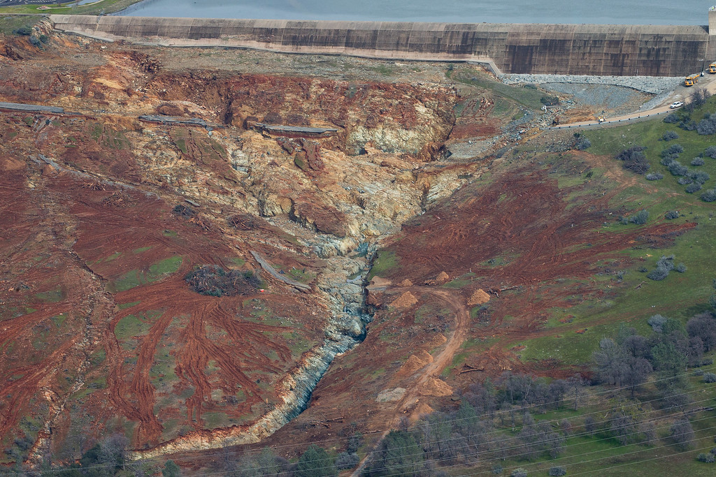 . OROVILLE, CA - FEBRUARY 13: The Oroville Lake emergency spillway and the erosion damage below it is seen from the air on February 13, 2017 in Oroville, California. The erosion damage is what caused officials to issue evacuation orders yesterday to over 188,000 people in downstream areas. (Photo by Elijah Nouvelage/Getty Images)